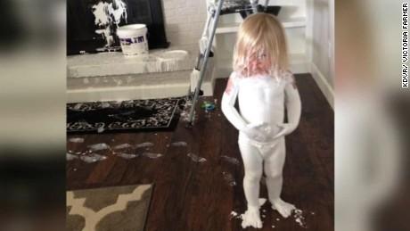 toddler dunks herself in paint bucket pkg _00003208