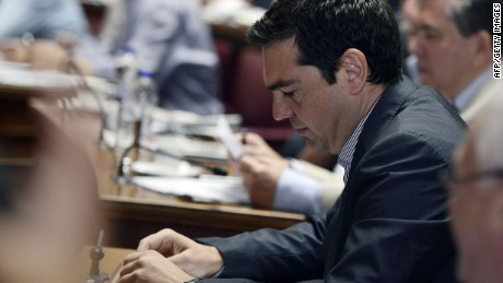 Greek Prime minister Alexis Tsipras attends his party's parliamentary group meeting at the Greek parliament in Athens on July 10, 2015. Greece on July 9, 2015 submitted to its eurozone creditors a new bailout plan proposing a pensions overhaul and tax hikes in return for debt relief and a three-year rescue loan. AFP PHOTO/ LOUISA GOULIAMAKILOUISA GOULIAMAKI/AFP/Getty Images