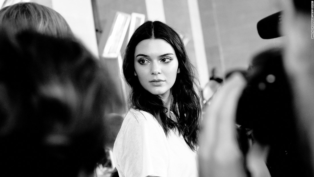 The fashion darling closed the show for Chanel and also walked alongside Lara Stone and Karlie Kloss during the Atelier Versace couture show this AW15. <br />Here, Kendall is pictured backstage at Atelier Versace AW15.