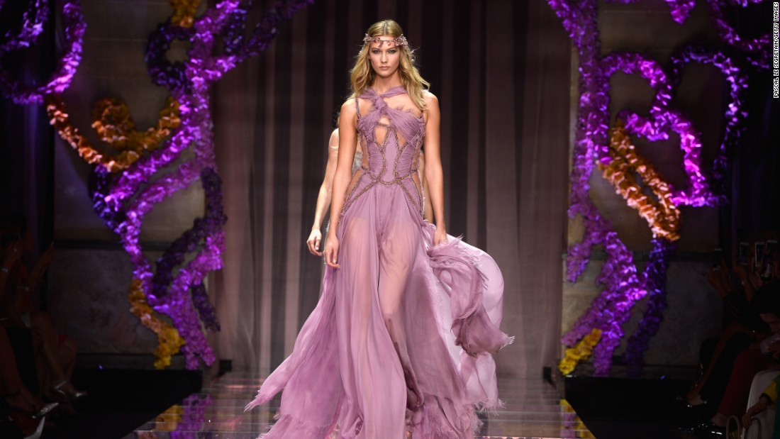 "Atelier Versace was forced not to show between 2004 and 2012 <a href=""http://www.harpersbazaar.co.uk/fashion/fashion-news/the-history-of-haute-couture#"" target=""_blank"">due to the recession</a>. <br />Here, model Karlie Kloss poses during the AW15 couture show."