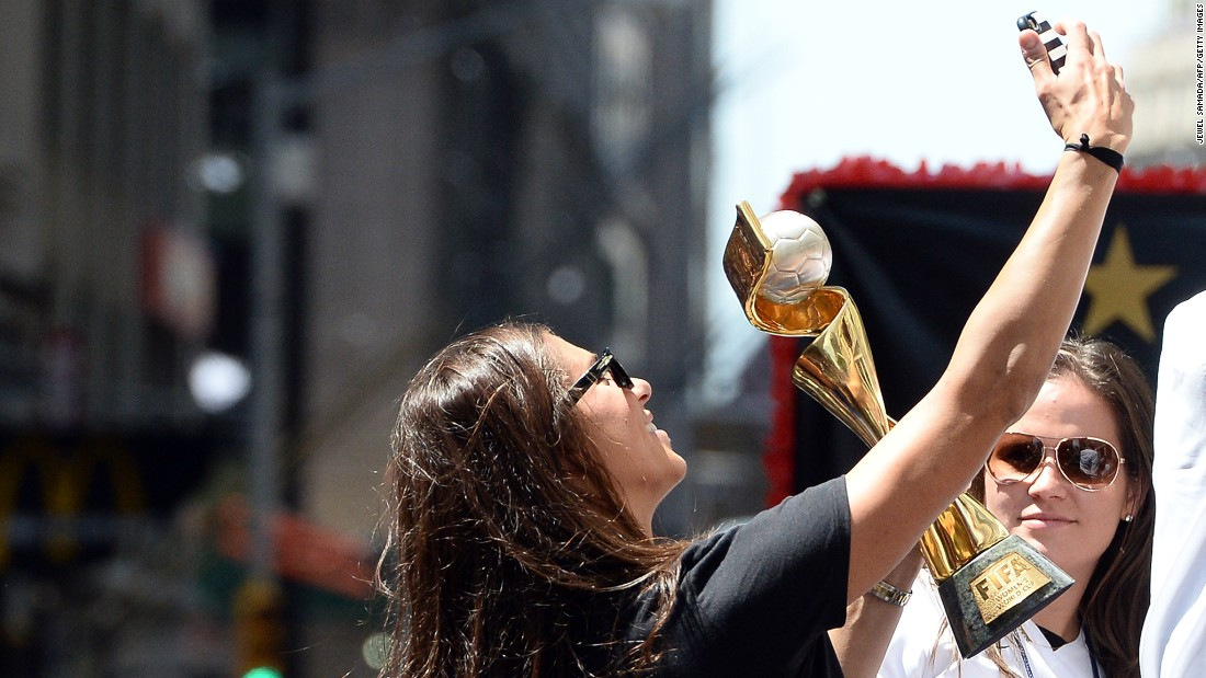 U.S. midfielder Carli Lloyd takes a selfie with the World Cup 2015 trophy during the ticker tape parade.