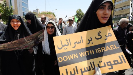 An Iranian woman holds a placard during a demonstration to mark the Quds (Jerusalem) International day in Tehran on July 10, 2015. AFP PHOTO / ATTA KENAREATTA KENARE/AFP/Getty Images
