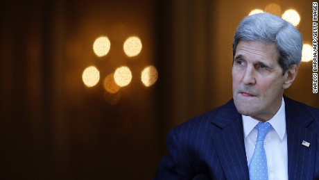 US Secretary of State John Kerry leaves his hotel on the way to mass at the St. Stephen's Cathedral in Vienna, Austria July 12, 2015 where the Iran nuclear talks meetings are being held. World powers raced to clinch a landmark deal to prevent Iran acquiring a nuclear bomb, with a source close to the marathon talks saying an agreement was '98-percent' completed. AFP PHOTO / POOL / CARLOS BARRIA (Photo credit should read CARLOS BARRIA/AFP/Getty Images)