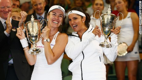 Sania Mirza of India and Martina Hingis of Switzerland celebrate with the trophy after winning the Final Of The Ladies' Doubles against Ekaterina Makarova of Russia and Elena Vesnina of Russia during day twelve of the Wimbledon Lawn Tennis Championships at the All England Lawn Tennis and Croquet Club on July 11, 2015 in London, England.
