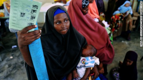 A Somali mother waits for her baby to be given a vaccine injection at a medical clinic in Mogadishu on April 24, 2013 as part of an initiative launched by the GAVI Alliance, UNICEF and WHO.