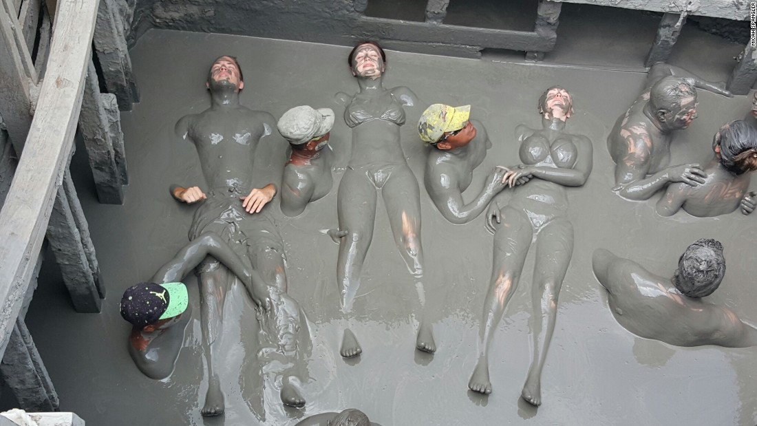 Colombia's mud volcano -- Volcán de Lodo El Totumo -- may be the country's messiest attraction. Attendants (in hats) slather bathers in mud once they're inside the volcano.
