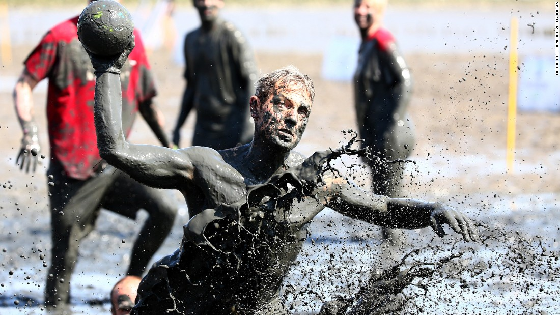 A man plays handball Saturday, July 11, during the Mudflat Olympic Games in Brunsbuttel, Germany.