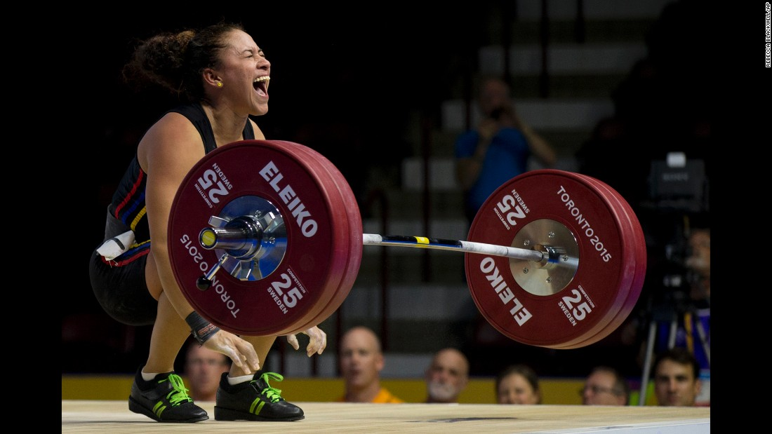 Venezuelan weightlifter Yusleidy Figueroa Roldan shouts after struggling on a lift attempt Sunday, July 12, during the Pan American Games. She won silver in her weight class.