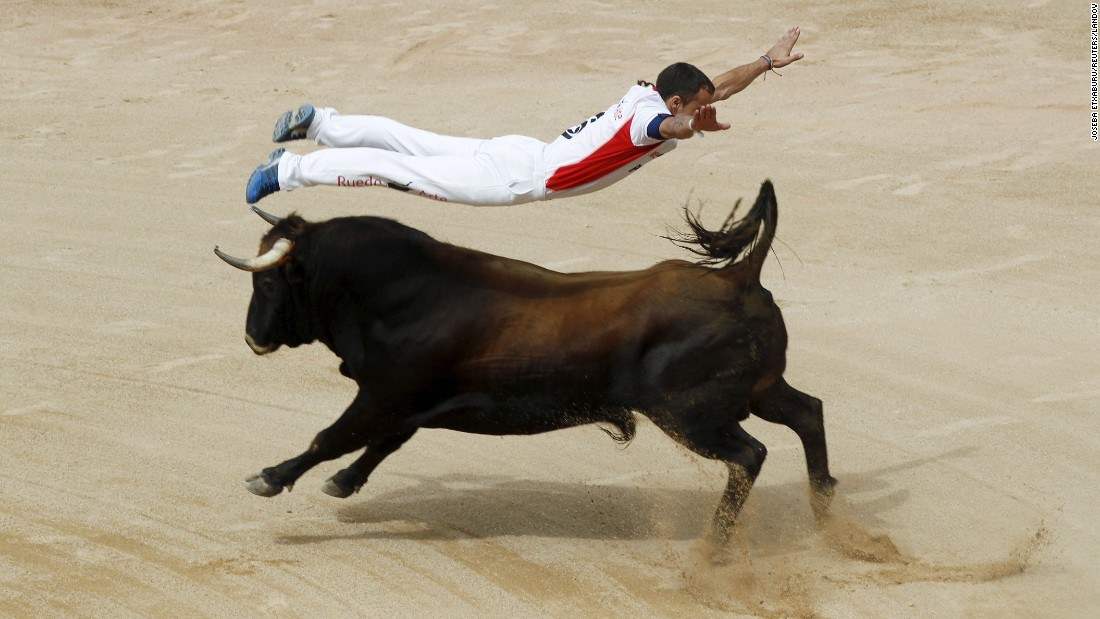 "A ""recortador"" jumps over a bull during the San Fermin festival in Pamplona, Spain, on Saturday, July 11."