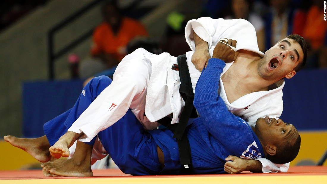 Canadian judoka Antoine Bouchard, top, reacts as the referee gives him the win over Cuba's Carlos Tondique at the Pan American Games on Sunday, July 12.