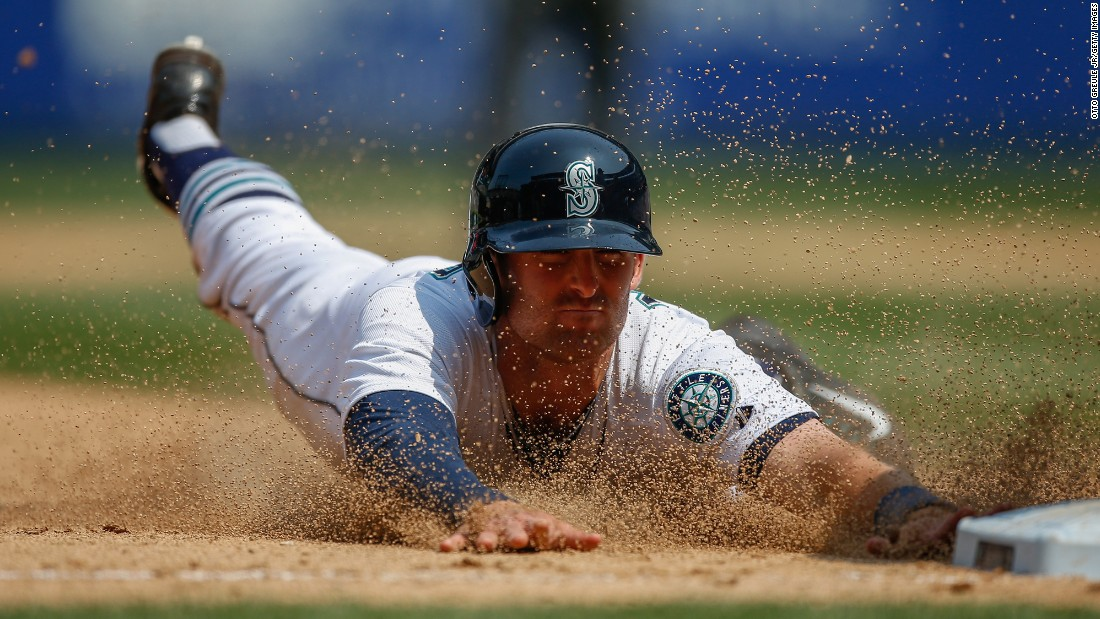 Seattle's Brad Miller steals third base during a home game against Detroit on Wednesday, July 8.