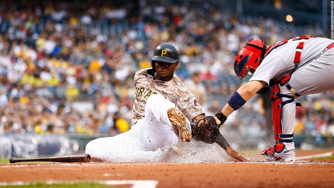 Pittsburgh's Gregory Polanco is tagged out at home plate by St. Louis catcher Yadier Molina on Thursday, July 9.