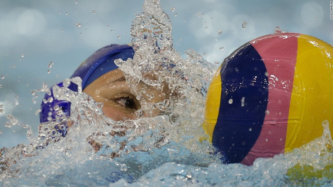 Brazil's Gabriela Mantellato Dias swims with the ball during a water polo match at the Pan American Games on Thursday, July 9.