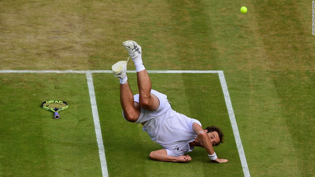 Richard Gasquet falls to the ground while playing Stanislas Wawrinka in the Wimbledon quarterfinals on Wednesday, July 8. Gasquet won the match in five sets, with the final set finishing 11-9.