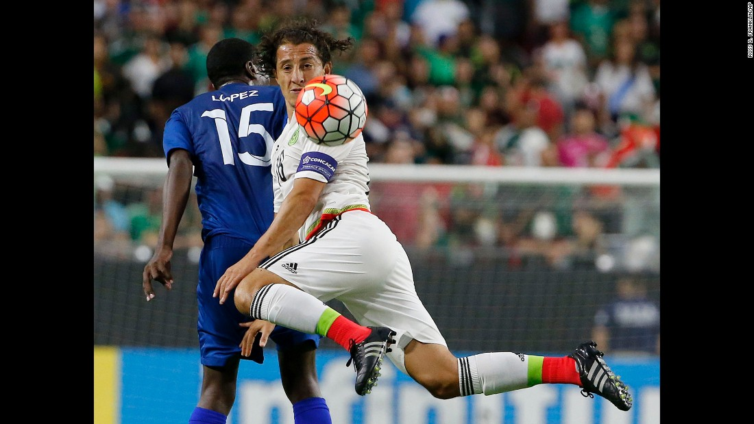 Mexico midfielder Andres Guardado kicks the ball in front of Guatemala defender Dennis Lopez during a Gold Cup match Sunday, July 12, in Glendale, Arizona.