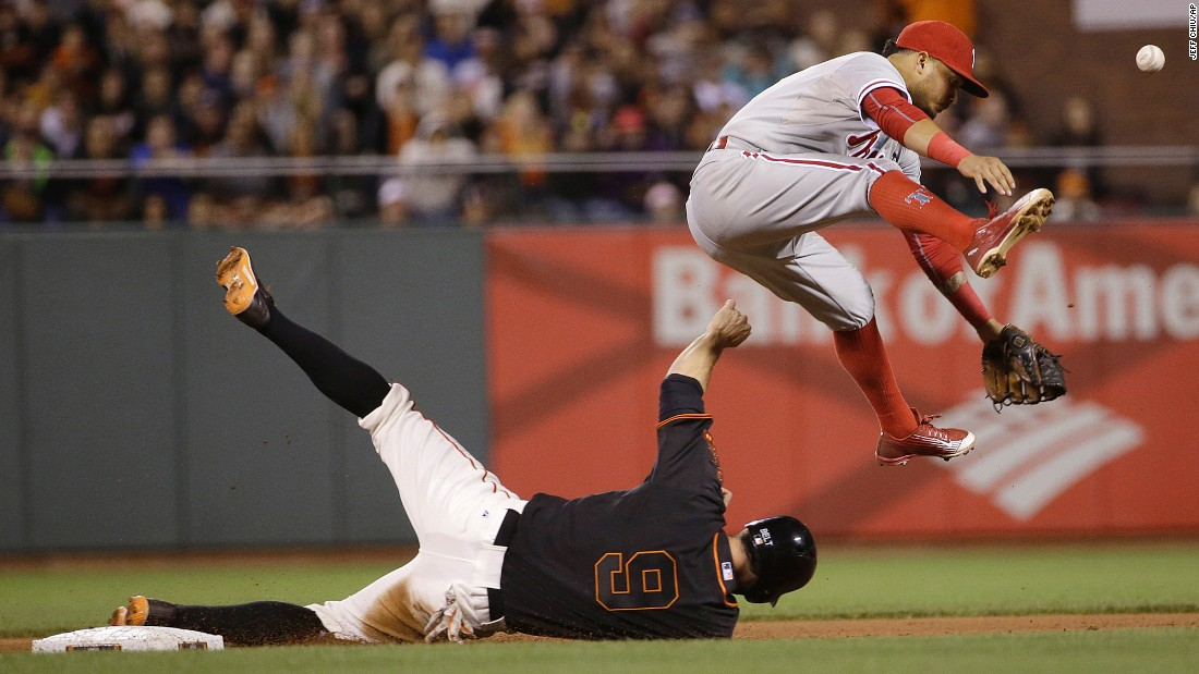 Philadelphia shortstop Freddy Galvis, top, loses the ball after forcing out San Francisco's Brandon Belt on Saturday, July 11.