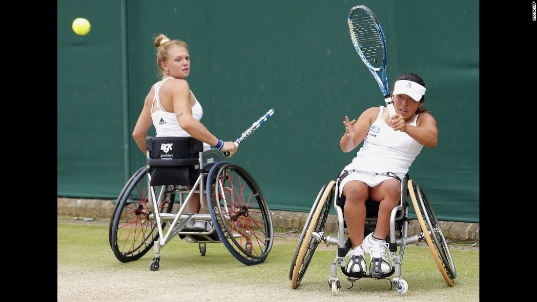 Yui Kamiji, right, and Jordanne Whiley play in Wimbledon's wheelchair doubles final against Jiske Griffioen and Aniek Van Koot on Sunday, July 12. Kamiji and Whiley won the match to defend their title.