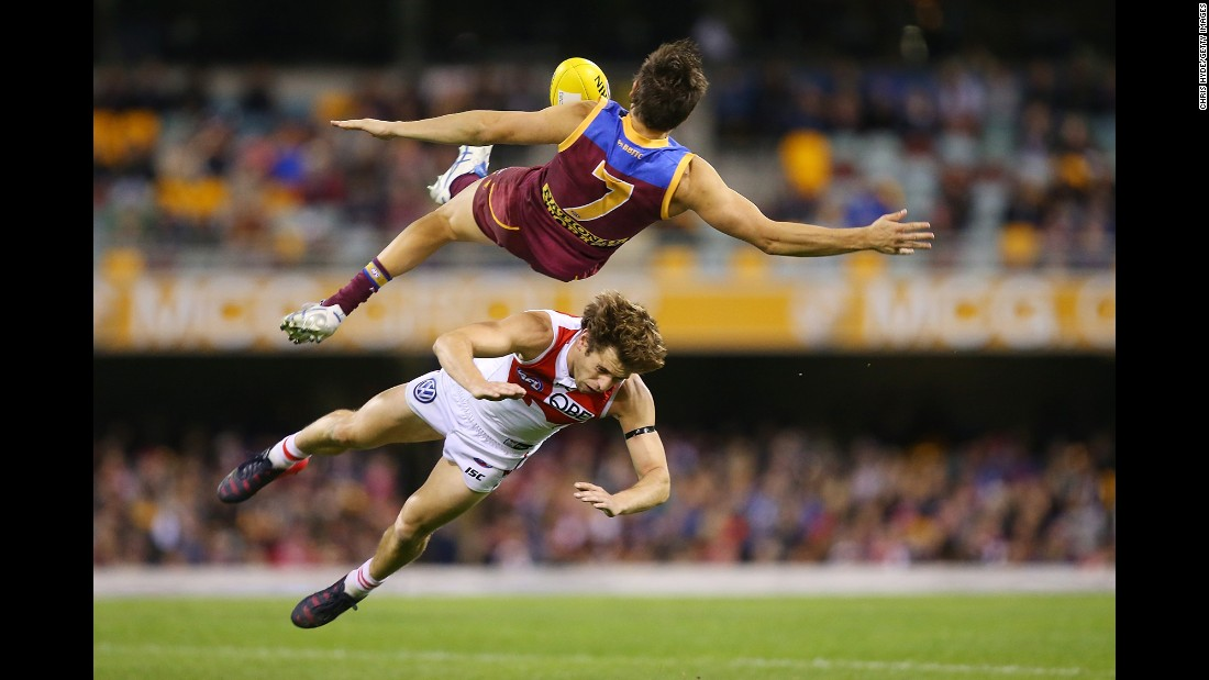 Brisbane's Jed Adcock goes flying after colliding with Sydney's Nick Smith during an Australian Football League match on Sunday, July 12.