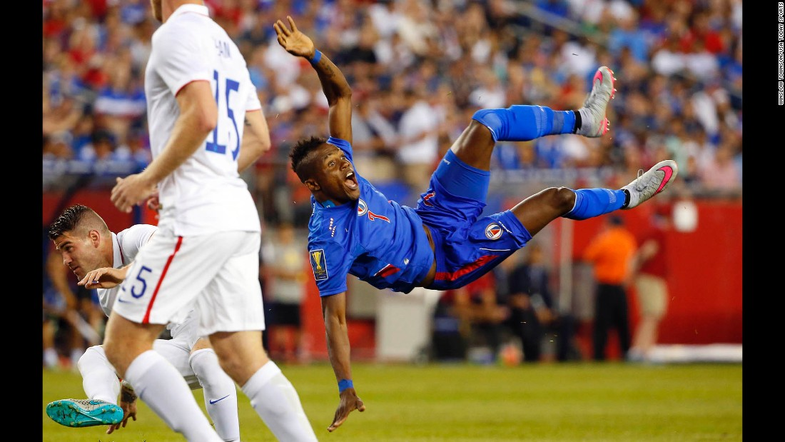 Haitian midfielder Wilde Donald Guerrier falls to the ground after attempting a bicycle kick against the United States on Friday, July 10.