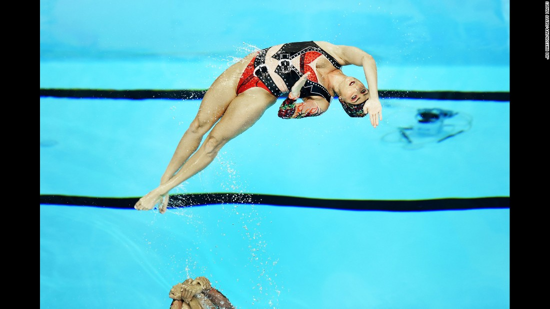 Synchronized swimmers from Brazil perform their technical routine during the Pan American Games on Thursday, July 9.