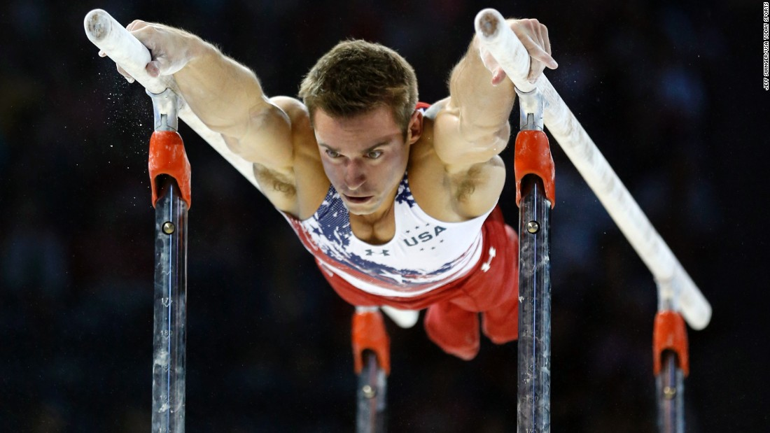 U.S. gymnast Samuel Mikulak competes on the parallel bars during the Pan American Games on Saturday, July 11. Mikulak and the Americans won gold in the team competition.