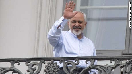 Iranian Foreign Minister Mohammad Javad Zarif waves from a balcony of the Palais Coburg Hotel where the Iran nuclear talks meetings are being held in Vienna, Austria on July 13, 2015.