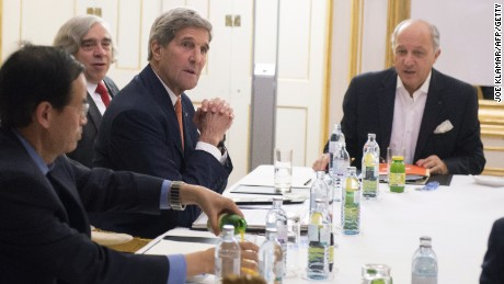 U.S. Secretary of State John Kerry (2nd R), U.S. Secretary of Energy Ernest Moniz (3rd R) and French Foreign Minister Laurent Fabius (R) meet at the Palais Coburg Hotel, where the Iran nuclear talks are being held, in Vienna, Austria on July 14.