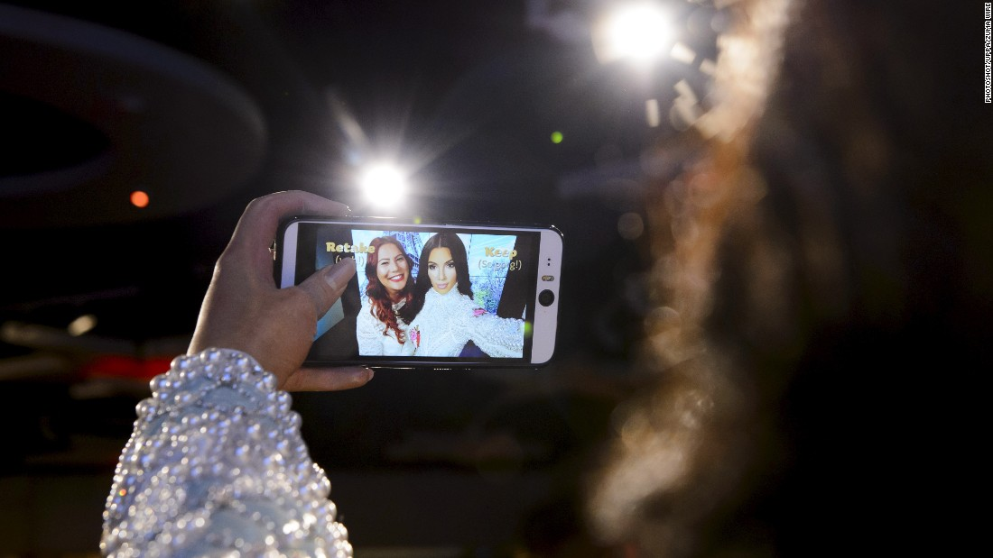 A woman has a selfie taken with a wax figure of Kim Kardashian after the figure was unveiled at Madame Tussauds in London on Thursday, July 9.