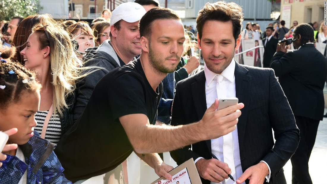 "A fan takes a photo with actor Paul Rudd at the London premiere of ""Ant-Man"" on Wednesday, July 8."