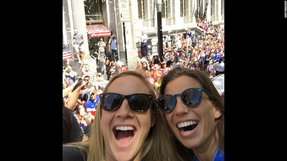 "U.S. soccer players Amy Rodriguez, left, and Tobin Heath take a selfie together at the team's New York City parade on Friday, July 10. ""WOW NYC YOU ROCK! #floating,"" <a href=""https://instagram.com/p/49wdU6sfsR/"" target=""_blank"">Heath said on Instagram.</a>"