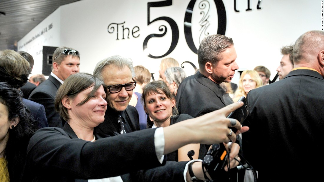 Actor Harvey Keitel stops to take a photo with fans during a film festival in Karlovy Vary, Czech Republic, on Saturday, July 11.