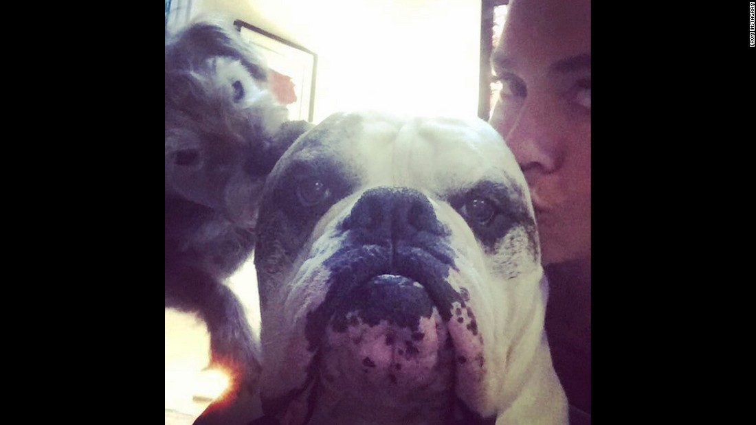 "U.S. swimmer Natalie Coughlin kisses one of her dogs on Wednesday, July 8. ""He gets all the ladies,"" <a href=""https://instagram.com/p/445KjmhDzk/"" target=""_blank"">she wrote on Instagram. </a>"