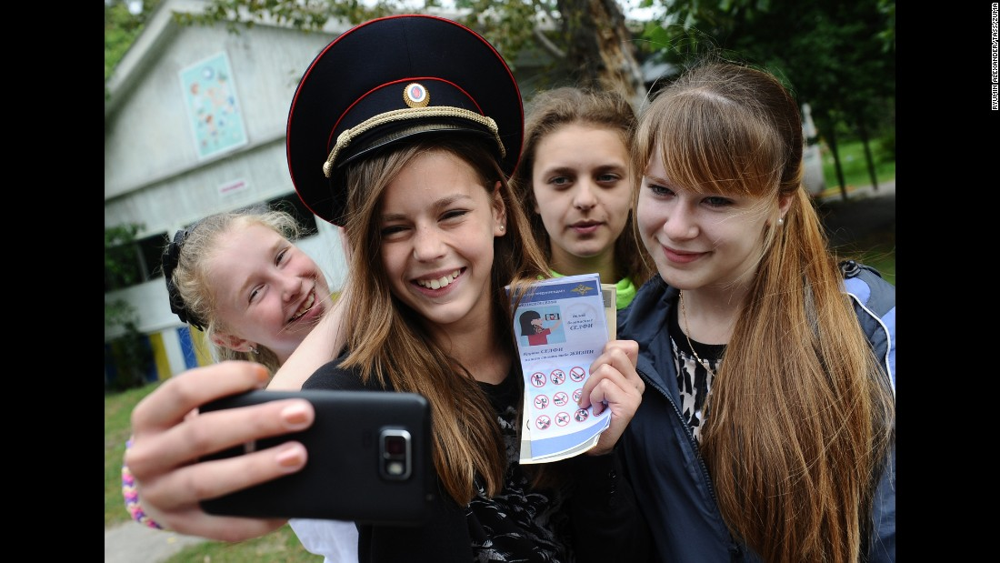 "A girl in Russia's Ryazan region takes a selfie with a leaflet, released by the country's Interior Ministry, that urges ""safe selfie"" practices on Monday, July 13. Russia <a href=""http://www.cnn.com/2015/07/08/asia/russia-selfie-death-brochure/"" target=""_blank"">launched the safe-selfie campaign</a> after a spate of recent selfie-related accidents."