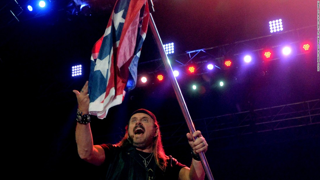 "Lynyrd Skynyrd trotted out the flag as a symbol of rebellion in the 1970s, as seen on <a href=""https://www.youtube.com/watch?v=ZVT-K82aoVI"" target=""_blank"">a clip of the band performing ""Sweet Home Alabama"" in 1975</a>. The group's Gary Rossington<a href=""http://newsroom.blogs.cnn.com/2012/09/09/lynyrd-skynyrd-talks-southern-roots/""> told CNN in 2012</a> that it would stop using it, though <a href=""http://theboot.com/lynyrd-skynyrd-confederate-flag/"" target=""_blank"">Skynyrd soon brought it back</a>. But now <a href=""http://www.nola.com/music/index.ssf/2015/06/even_lynyrd_skynyrd_wanted_to.html"" target=""_blank"">they give American flags more prominence</a>."