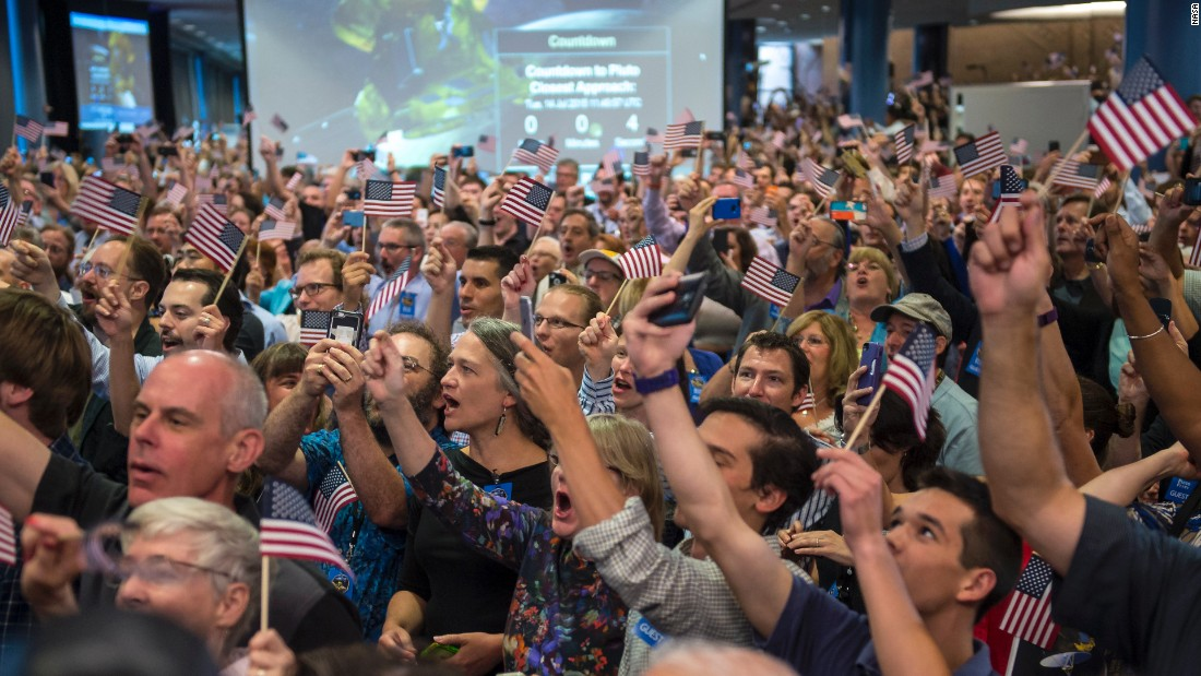 NASA team members and guests count down to the spacecraft's approach to Pluto on July 14.