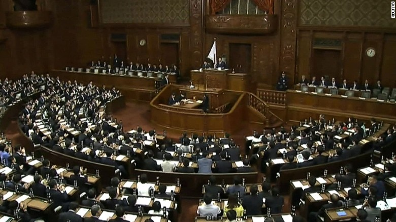 Japan's lower house approves unpopular security bills