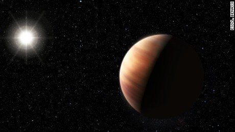 An artist's impression shows Jupiter's twin, a gas giant planet, in orbit around sun-like star HIP 11915.