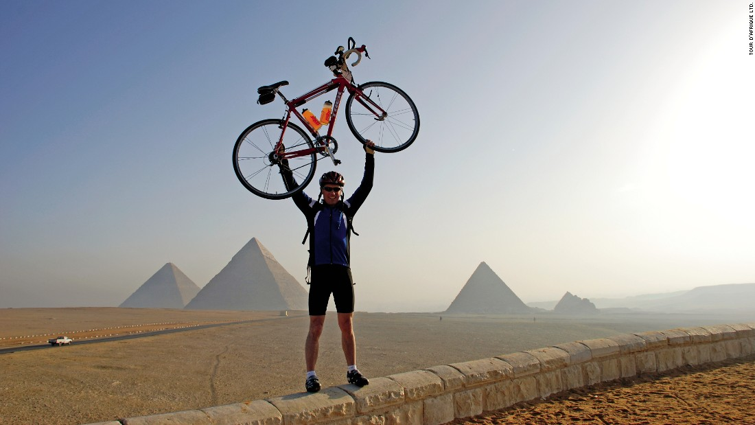 The challenge of nearly 7,500 miles on a bike is what draws riders to the transcontinental Tour d'Afrique. That and, of course, a chance to ride past the Egyptian pyramids, alongside elephants and near the banks of the Nile River.