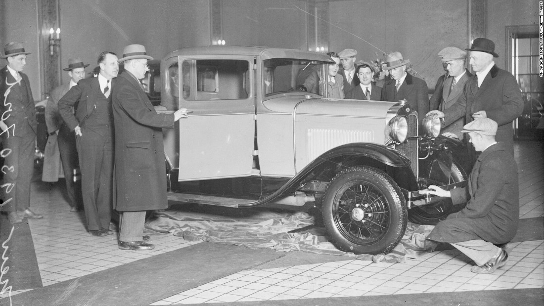 "Ford's updated Model A was introduced to the public in late 1927. The anticipation for the car, designed by a group led by Ford's son Edsel, might be compared to the frenzy surrounding a new Apple product: According to Ford News, <a href=""http://blog.hemmings.com/index.php/2013/12/02/this-day-in-history-1927-ford-reveals-its-model-a-to-an-eager-public/"" target=""_blank"">more than 10 million people came to look at the car</a> when it went on sale on December 2, 1927. It was still attracting attention in January 1930, when these men came to look one over in Chicago."