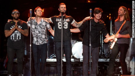 Michael Madden, PJ Morton, Adam Levine, James Valentine, Jesse Carmichael, and Matt Flynn of Maroon 5 perform at The Forum on April 4, 2015 in Inglewood, California.