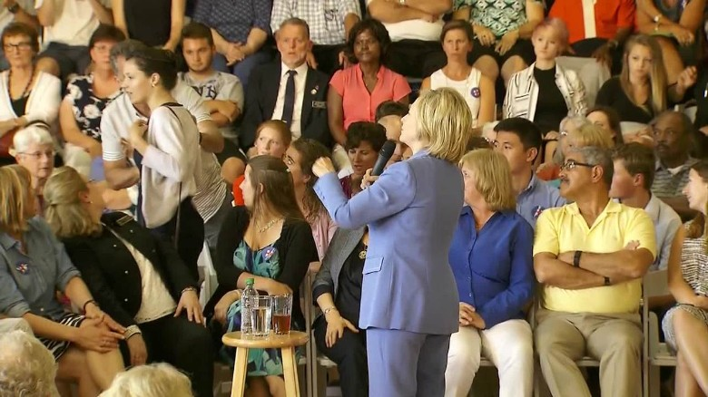 Clinton confronted by climate change protests at town hall