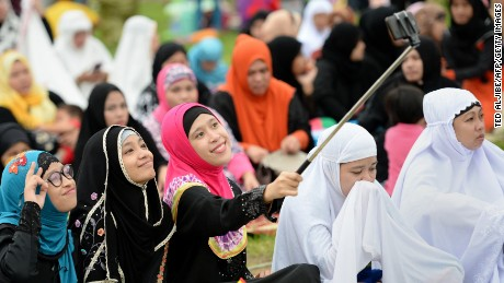 """Young Muslims devotees take a """"selfie"""" prior to Friday prayers to mark the end of Ramadan in Manila last year."""