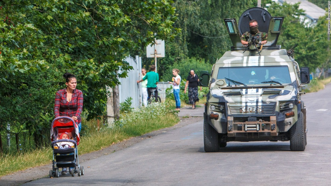 Ukrainian security forces patrol in the village of Bobrovyshche on July 14, 2015. More than 6,400 people have been killed in the conflict in Ukraine since April 2014, the United Nations says.