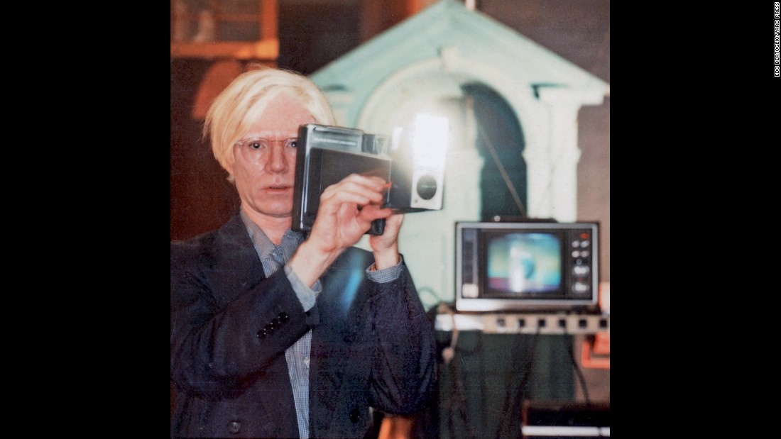 Andy Warhol took hundreds of Polaroids of actors, athletes, musicians and other artists. Here, he stands at The Factory, his New York studio, with a Polaroid Big Shot camera in 1978. He later transposed his Polaroid snapshot onto canvas.