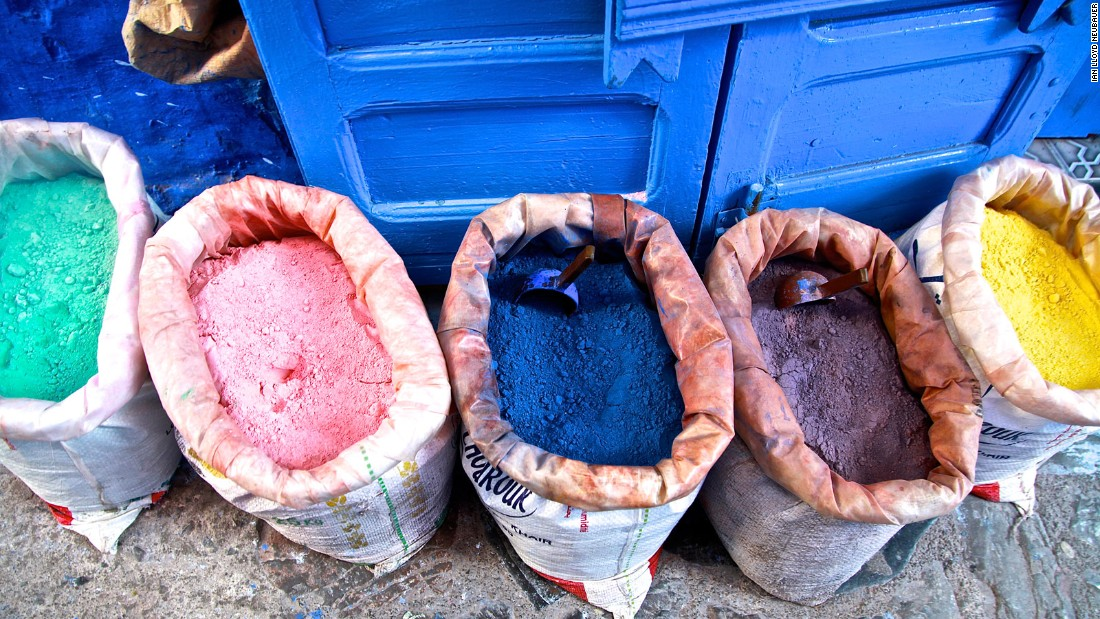 The entire city needs a fresh coat of blue paint every two years. It's done in stages -- a never-ending chore accomplished with powdered pigment like these. The bags are a common sight outside shops around the city. The pigment is mixed with water and is often applied with a traditional brush made of dried grass tied in a bundle.