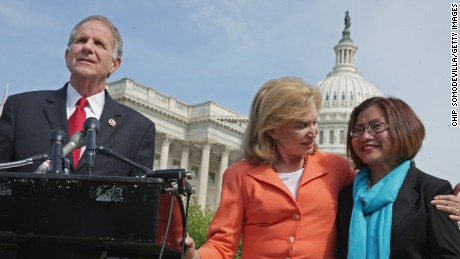 Human trafficking survivor and activist Shandra Woworunti, right, with Victims' Rights Representative Ted Poe and Representative Carolyn Maloney at a news conference at the U.S. Capitol last year.