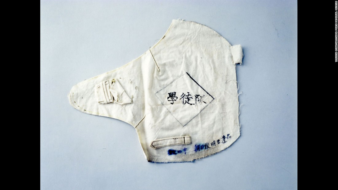 "Toshiaki Asahi was a 13-year-old high school student who was working at the time of the attack and wearing this armband. Despite serious burns, he managed to make his way through fires sparked by the bomb. He climbed up a riverbank and escaped to the outskirts of the city. There he was found by an acquaintance and carried home. Three days later, he told family members, ""Thank you for all you've done,"" and died in his mother's lap."