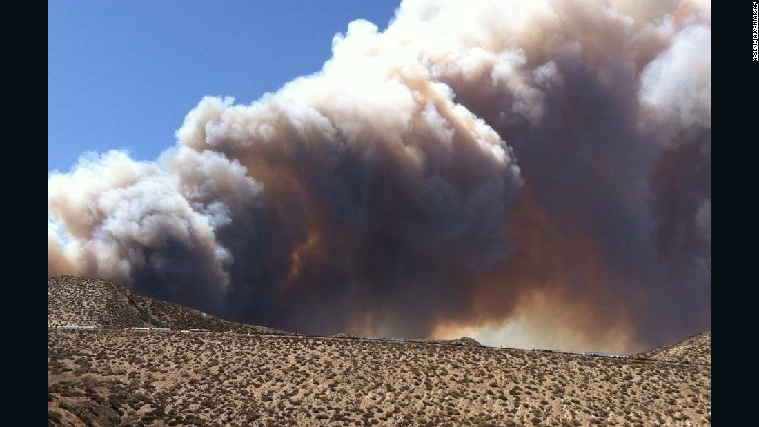 Smoke from a wildfire rises above Interstate 15 near San Bernardino, California, on July 17.