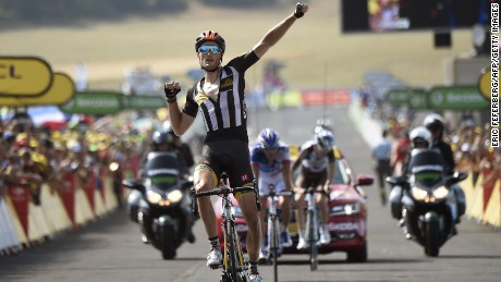 Steve Cummings celebrates as he crosses the finish line of the 14th stage of the 102nd Tour de France.