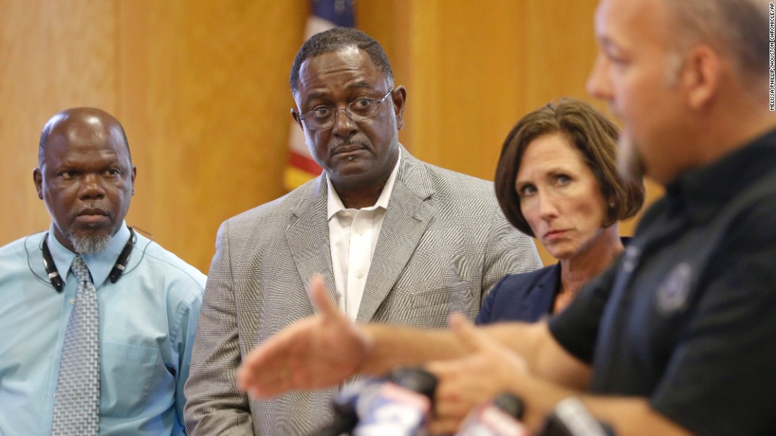"From left, Hempstead Mayor Michael Wolfe, Prairie View Mayor Frank Jackson and Texas state Sen. Lois Kolkhorst listen as Waller County District Attorney Elton Mathis, right, speaks to the media in Hempstead on July 17. ""The death of Sandra Bland will not be swept under the rug,"" Mathis said. The Texas Rangers and the FBI are investigating her death."